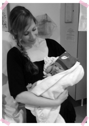 Photo of doula Rachel holding a baby